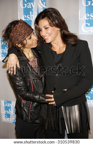 BEVERLY HILLS, CA - MAY 19, 2012: Gina Gershon and Linda Perry at the L.A. Gay and Lesbian Center's 'An Evening With Women' held at the Beverly Hilton Hotel in Beverly Hills, USA on May 19, 2012. - stock photo