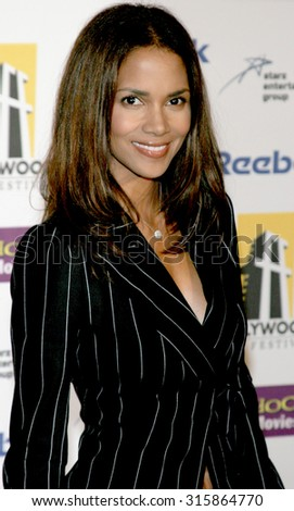 BEVERLY HILLS, CA - OCTOBER 24, 2005: Halle Berry at the 2005 Hollywood Film Festival Awards Gala Ceremony held at the Beverly Hilton Hotel in Beverly Hills, USA on October 24, 2005. - stock photo