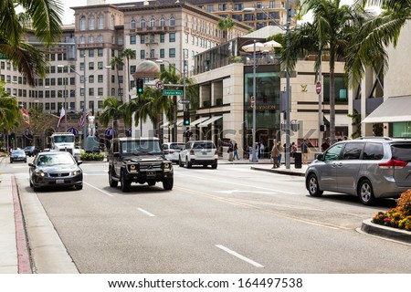 BEVERLY HILLS, CA - SEP 20: Rodeo Drive in Beverly Hills on September 20, 2013. Rodeo Drive is an affluent shopping district known for designer label and haute couture fashion. - stock photo