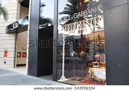 BEVERLY HILLS, CALIFORNIA - DECEMBER 7: Dolce & Gabbana store at Rodeo Drive as seen on December 7, 2012 in Beverly Hills, California. There are more than 100 world-renowned boutiques in this area. - stock photo
