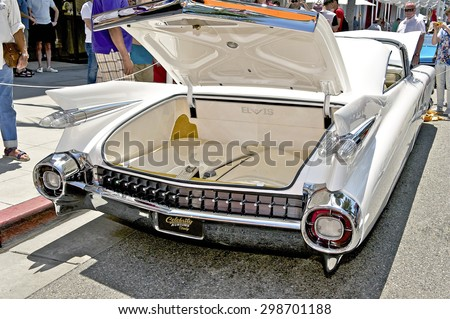 """BEVERLY HILLS, CALIFORNIA - JUNE 21, 2015: 1959 Cadillac Coupe De Ville  """"Elvis III"""" on display at the Rodeo Drive Concours D' Elegance on June 21, 2015 Beverly Hills, California, USA - stock photo"""