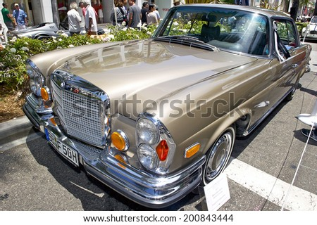 BEVERLY HILLS/CALIFORNIA - JUNE 15, 2014: 1971 Mercedes Benz 280 SE 3.5 Coupe owned by Juaquin A. Vaquerano at the Rodeo Drive Concours D'Elegance June 15, 2014 Beverly Hills, California USA - stock photo