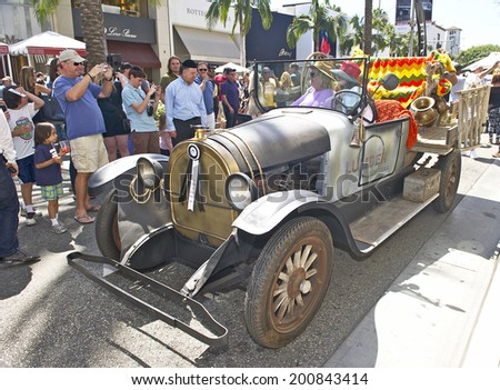 """BEVERLY HILLS/CALIFORNIA - JUNE 15, 2014: 1924 Reo truck from televisions """"Beverly Hillbillies"""" owned by Jim Johnson at the Rodeo Drive Concours D'Elegance June 15, 2014 Beverly Hills, California, USA - stock photo"""