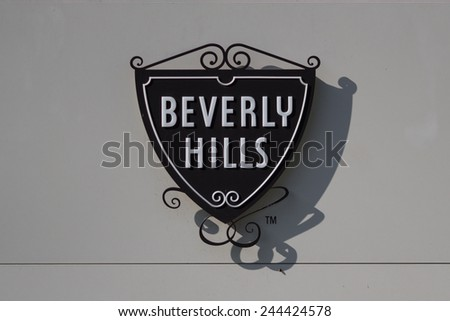 BEVERLY HILLS, CALIFORNIA - NOV 10 2014: The famous Beverly Hills symbol and sign on the exterior of the Beverly Hills Police Station. - stock photo