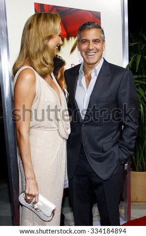 """BEVERLY HILLS, CALIFORNIA - November 15, 2011. George Clooney and Stacy Keibler at the Los Angeles Premiere of """"The Descendants"""" held at the AMPAS Samuel Goldwyn Theater, Los Angeles.  - stock photo"""