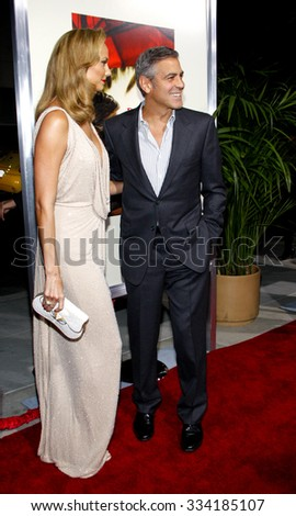 "BEVERLY HILLS, CALIFORNIA - November 15, 2011. George Clooney and Stacy Keibler at the Los Angeles Premiere of ""The Descendants"" held at the AMPAS Samuel Goldwyn Theater, Los Angeles."