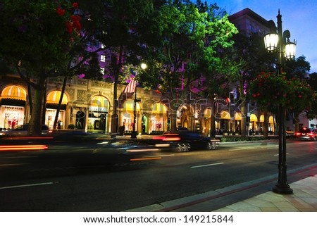 BEVERLY HILLS, CALIFORNIA, USA - JULY 27, 2013 : Cars passing the Beverly Wilshire Hotel on Wilshire Boulevard in Los Angeles on July 27, 2013 in Beverly Hills, California.  - stock photo