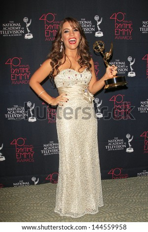 BEVERLY HILLS - JUN 16: Kristen Alderson with the Outstanding Younger Actress In A Drama Series award for 'General Hospital' - 40th Annual Daytime Emmy Awards on June 16, 2013 in Beverly Hills, CA  - stock photo