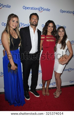 BEVERLY HILLS - OCT 2: David Charvet, Brooke Burke, daughters at the Operation Smile's 2015 Smile Gala  on October 2, 2015 at the Beverly Wilshire Four Seasons Hotel in Beverly Hills, CA. - stock photo