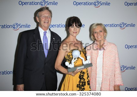 BEVERLY HILLS - OCT 2: Dr Bill Magee, Selma Blair, Kathy Magee at the Operation Smile's 2015 Smile Gala  on October 2, 2015 at the Beverly Wilshire Four Seasons Hotel in Beverly Hills, CA. - stock photo