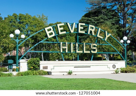 Beverly Hills sign in Los Angeles park with beautiful blue sky in background
