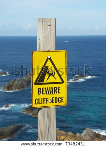 Beware of Cliff Edge Sign at Booti Booti National Park of Australia. - stock photo