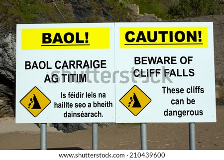 beware of cliff falls warning sign beside the cliffs in Ballybunion county Kerry Ireland