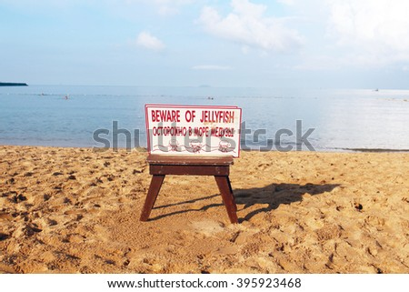 Beware of Jellyfish warning sign on the beach in Thailand - stock photo