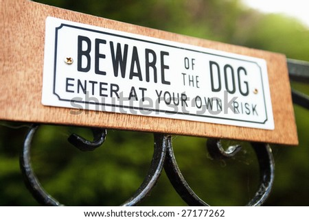 Beware of the dog sign on gate