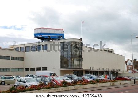 BEXHILL-ON-SEA, ENGLAND - SEPTEMBER 12: A life size replica of a coach, by British artist Richard Wilson, hangs off the roof of the De La Warr Pavilion on September 12, 2012 at Bexhill-on-Sea, Sussex.