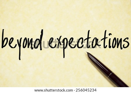 beyond expectations text write on paper  - stock photo