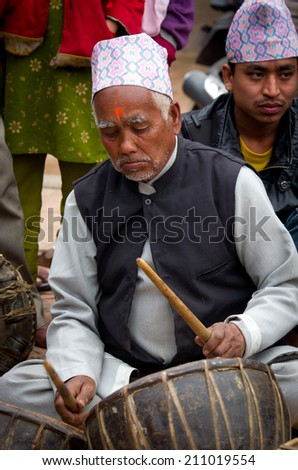 BHAKTAPUR, NEPAL - APR 05: Unidentified musicians performing live music on the street  on Apr 05, 2014 in Bhaktapur, Nepal.