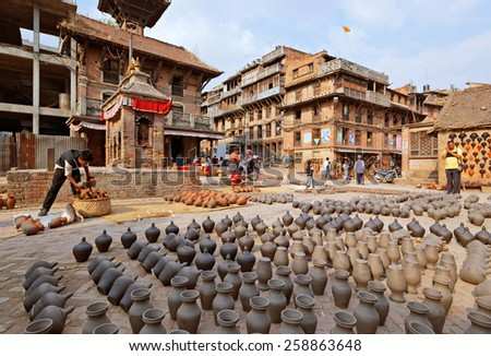 BHAKTAPUR, NEPAL - APRIL 5: Bhaktapur pottery market square on April 5, 2009 in Bhaktapur, Nepal. Bhaktapur is listed as a World Heritage Site by UNESCO. - stock photo