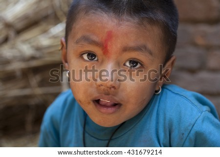 BHAKTAPUR, NEPAL - NOVEMBER 1, 2013: A portrait of a little nepalese boy photographed in Bhaktapur, Nepal