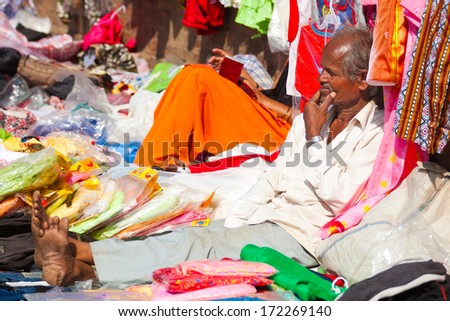 BHAKTAPUR, NEPAL - OCT 20: Unidentified Newari man selling clothes on the street on Oct 20, 2007 in Bhaktapur, Nepal. The Newars are the indigenous people of the Kathmandu Valley in Nepal.