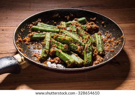 bhindi masala or bhendi masala or ladies finger masala / curry in fry pan - stock photo