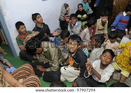 BHOPAL- DECEMBER 2:  Patients of a clinic for Bhopal victims enjoying during a children's day celebration in Bhopal - India on December 2, 2010. - stock photo