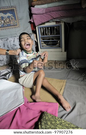 BHOPAL- NOVEMBER 30:  10 years old Sahil suffering from Cerebral Palsy from birth caused allegedly by toxic chemicals in her mother's body in their small room  in  Bhopal - India on November 30 2010.
