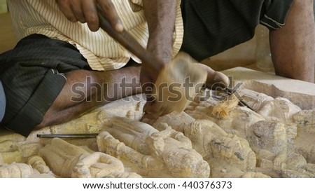 BHUBANESWAR, INDIA - 25 MAY, 2016: An unidentified Indian stone artist carving designs in stone in Bhubaneswar, India.