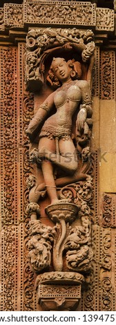 Bhubaneswar, India - Sculptures of female dancer on ancient Hindu temples made of sand stones in approximately 11th century.