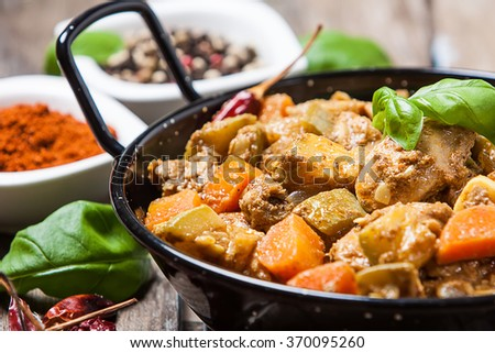 bhuna chicken curry style with tomato and tamarind marinade - stock photo