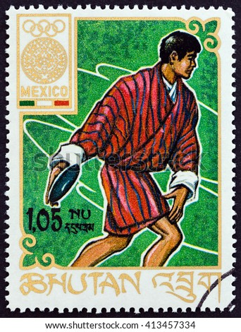 """BHUTAN - CIRCA 1968: A stamp printed in Bhutan from the """"Olympic Games, Mexico """" issue shows discus throw, circa 1968.  - stock photo"""