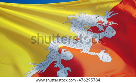Bhutan flag waving against clean blue sky, close up, isolated with clipping mask alpha channel transparency