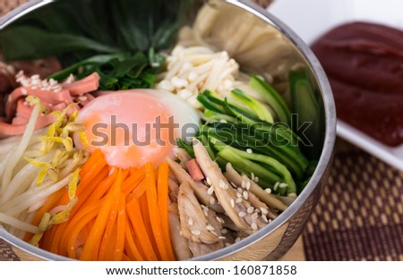 bibimbap, The introduction of various kinds of vegetables mixed with spicy sauce - stock photo