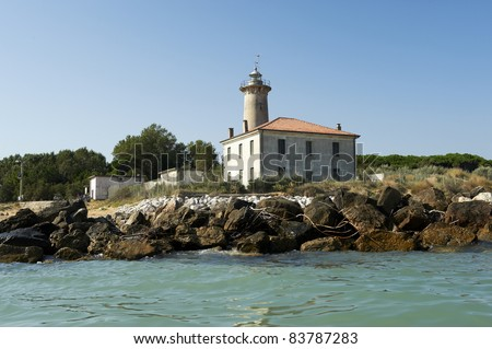 Bibione (Ve),Veneto,Italy,Adriatic Sea,the lighthouse on the  beach at the mouth of the river Tagliamento