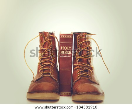 Bible and boots - stock photo