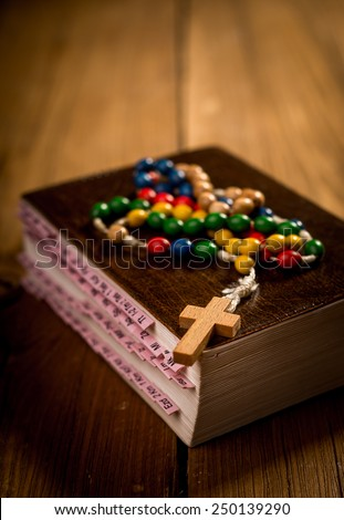 Bible and cross, symbols of Christianity - stock photo