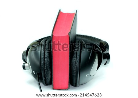 Bible and headphones on white background