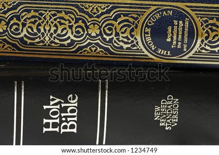 Bible and Koran (Qur'an) - stock photo