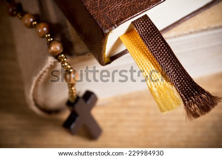 bible and old wooden rosary - stock photo