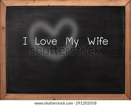 Bible love concept applicable on I Love My Wife rylics over wooden frame blackboard wooden - stock photo