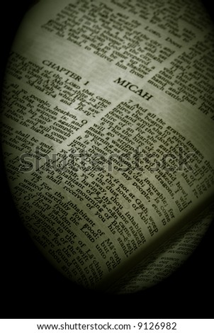 Bible Series. close up detail of antique holy bible open to the book of Micah in the old testament finished in sepia