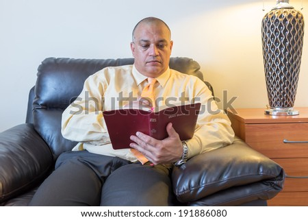Bible study. Man looking up in the Bible. Close up of a pastor or religious teacher hands working with the Bible.