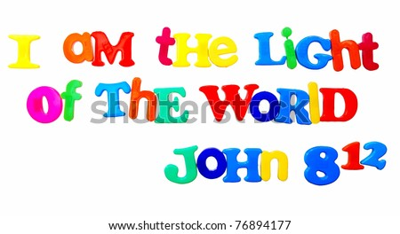 """bible verse John 8:12 """"I am the light of the world"""" written in colorful plastic letters, isolated on white - stock photo"""