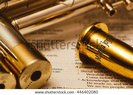Bible verse on gold trumpet mouthpiece