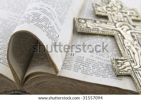 Bible with big gold cross on it