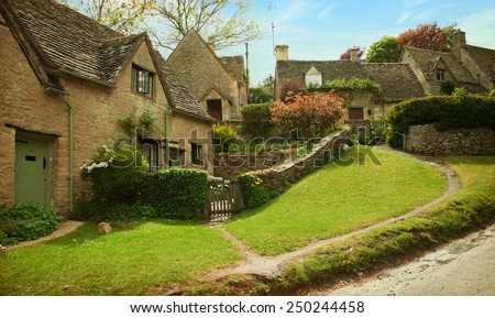 Bibury. Cotswold stone cottages in  beautiful spring day.  England, UK. - stock photo