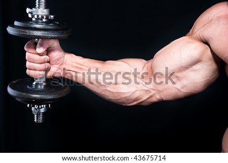 Bicep with hand weights  close up , isolated on black background - stock photo