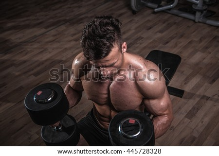 Biceps workout. - stock photo