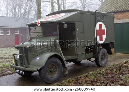 BICESTER, UK - JANUARY 4: A vintage ex RAF Ambulance support vehicle is displayed at the Bicester Heritage site during the Sunday Brunch Scramble meeting on January 4, 2015 in Bicester - stock photo